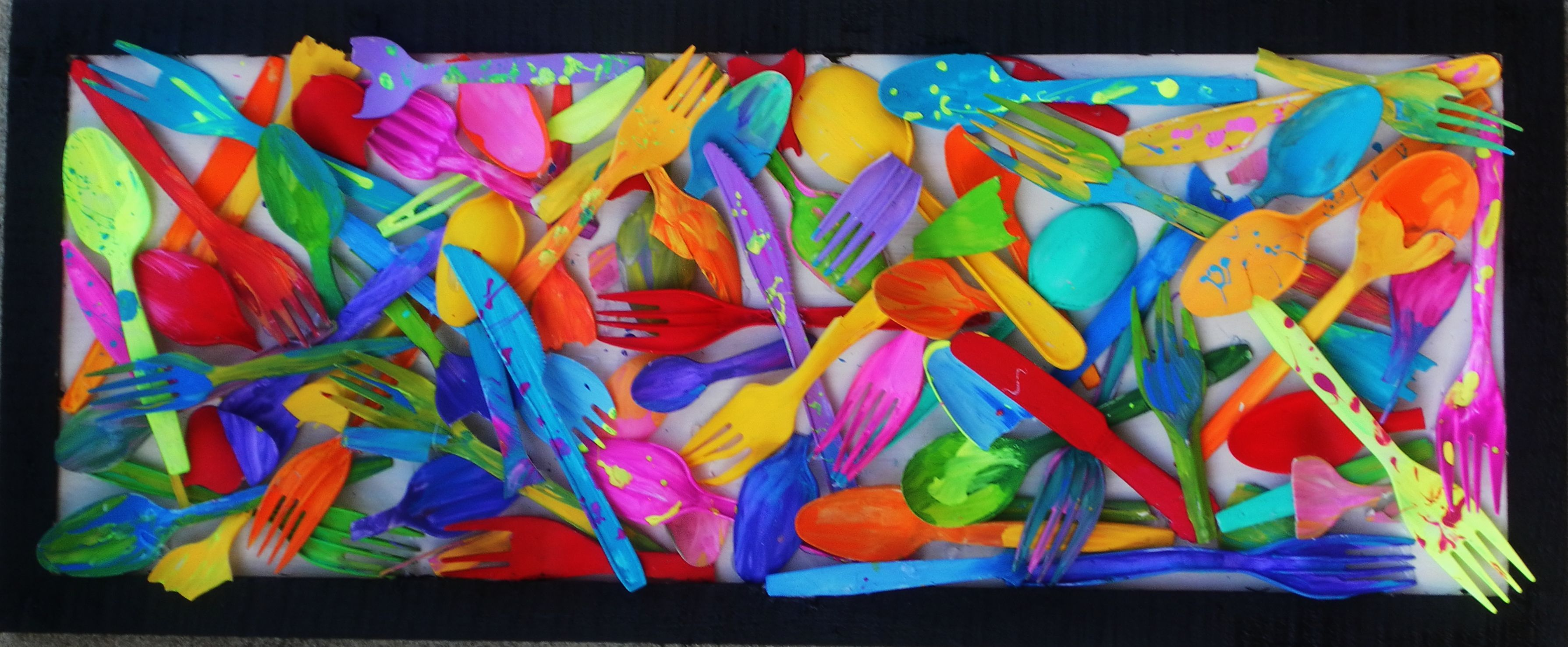 All these plastic utensils were found on the beach and repainted and glued to show artsy them up.