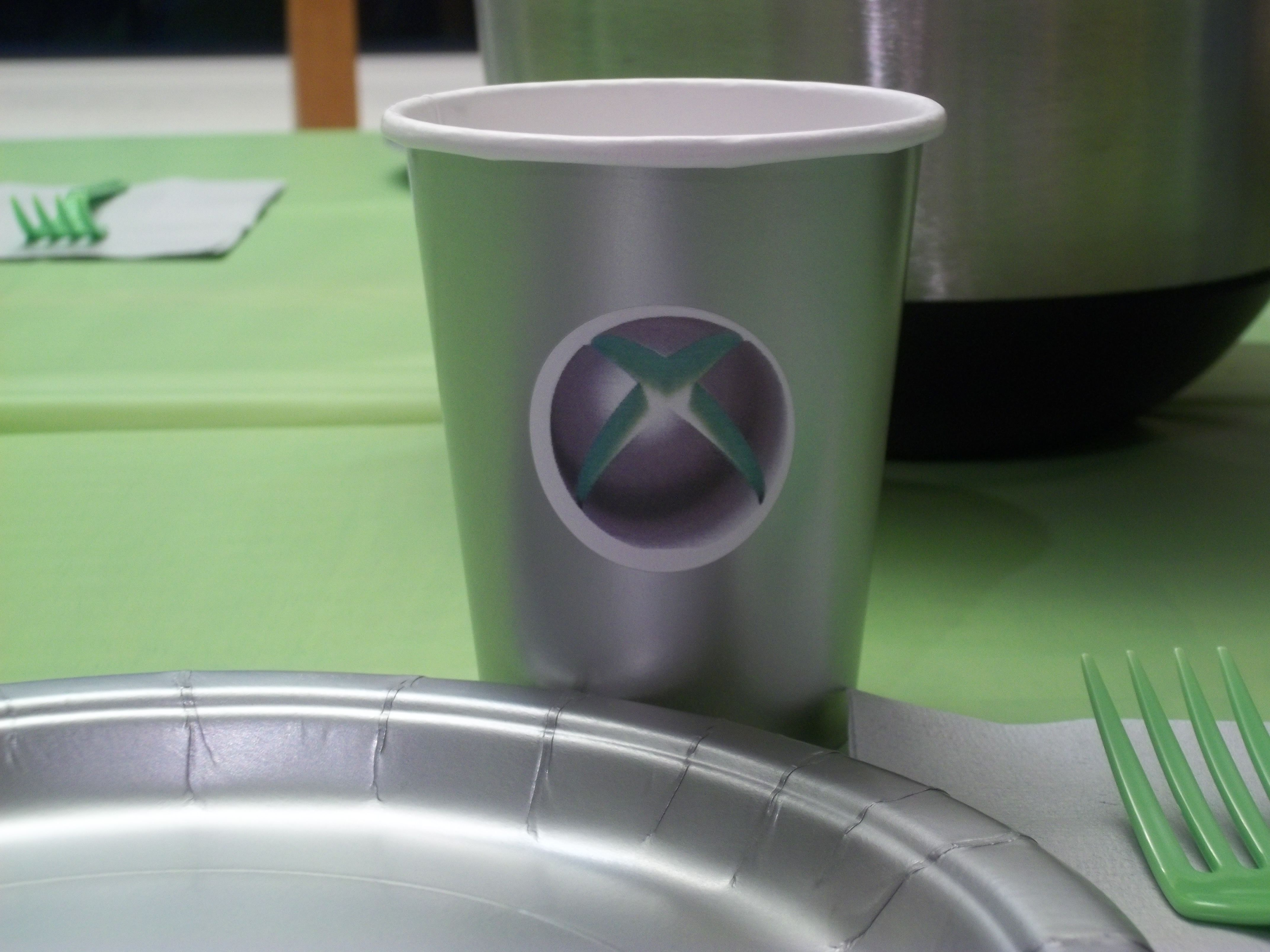 silver cup from the dollar store print xbox logo on round shipping label apply