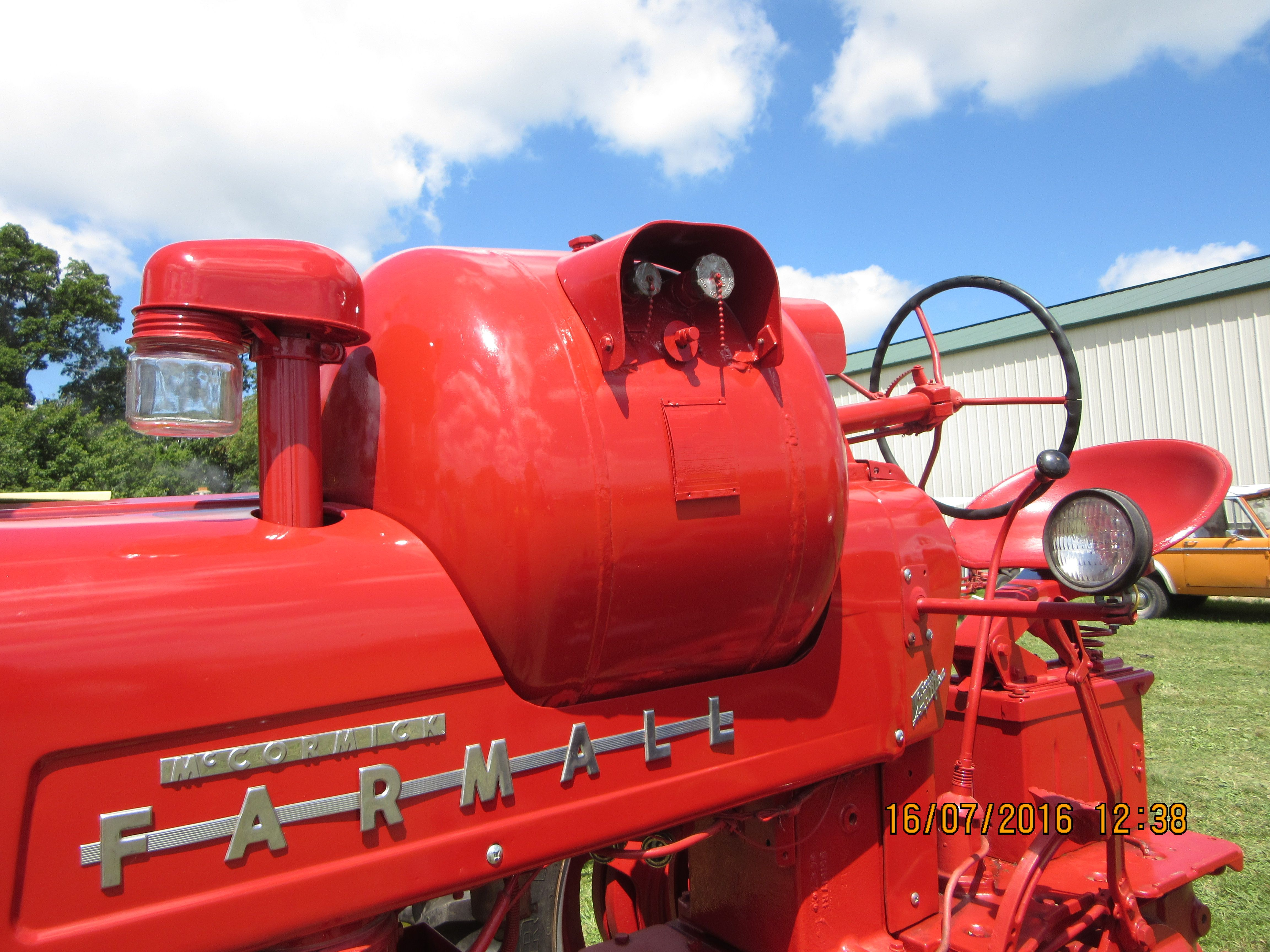 closeup of 1955 farmall 400 lpg red tractor tractors case ih international harvester [ 4608 x 3456 Pixel ]