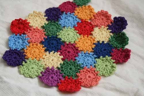 Yo-yo afghan - great to use up your yarn scraps but one suggestion I ...