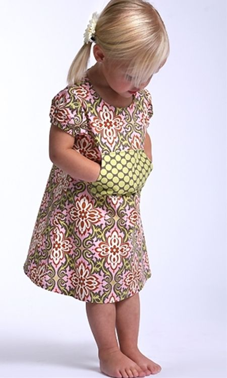 Pocket dress  No longer available on that website.  Looks like something that could be done with many little girl dress patterns.  cute idea!