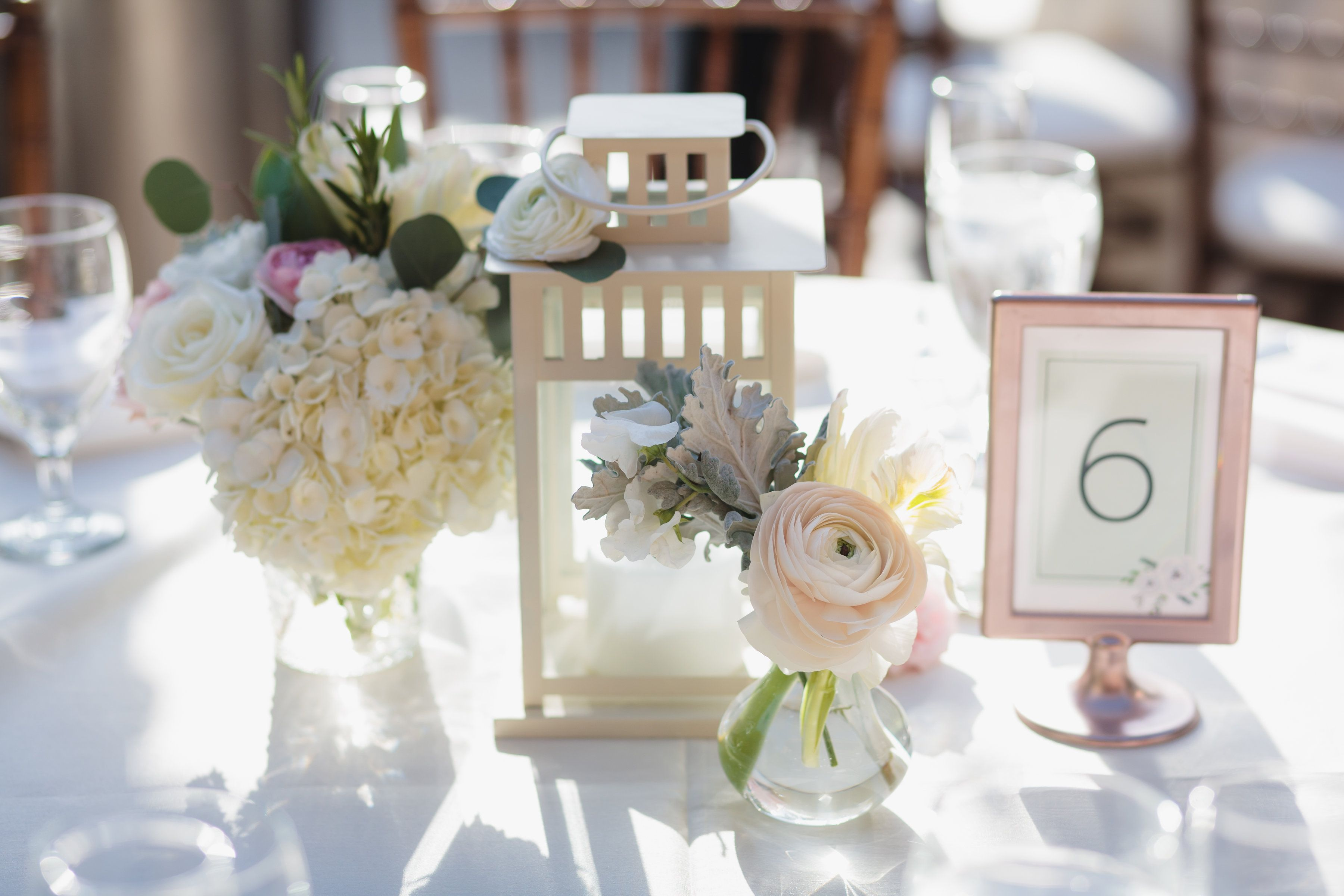 Lantern Centerpiece with flowers including hydrangea, ranunculus ...