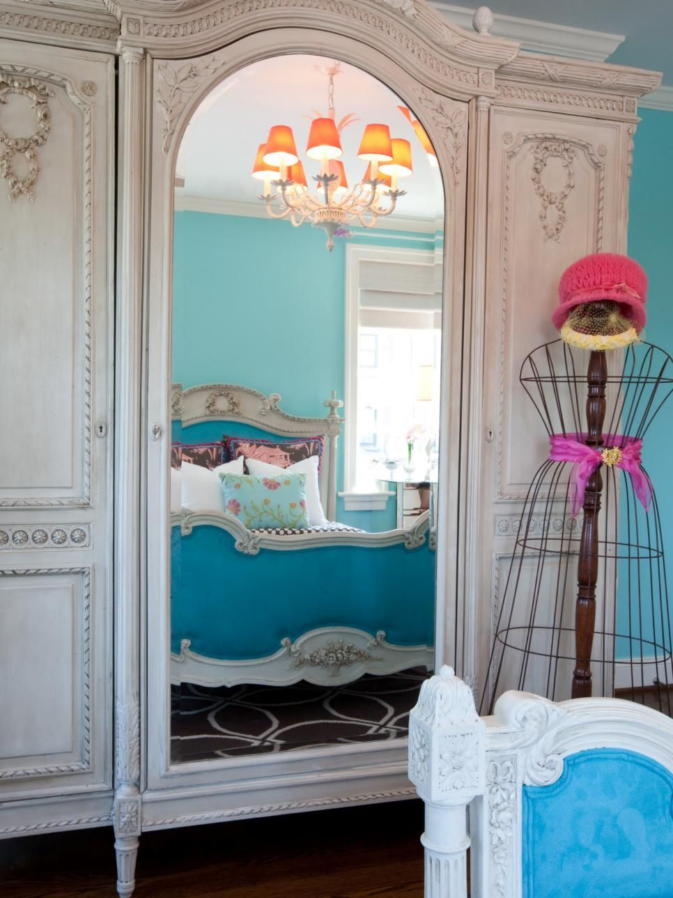 a mirrored french victorian armoire reflects a matching bed in this eclectic teen bedroom