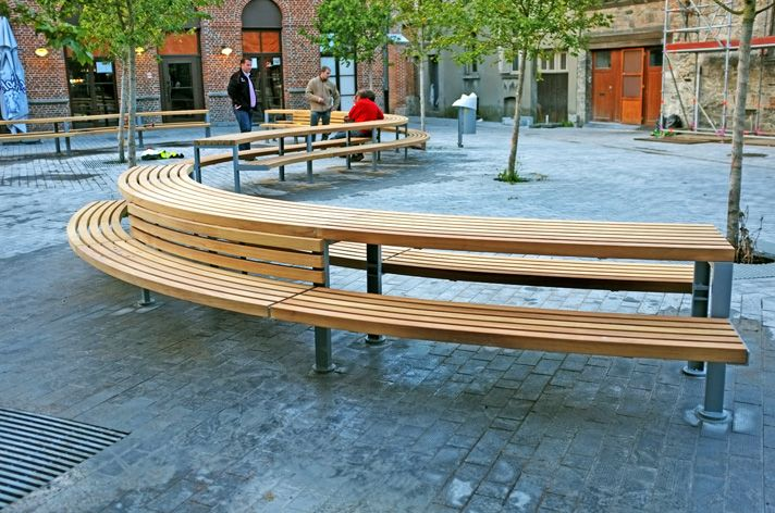 The picnic units comprised of large curved FSC® Iroko slats mounted onto a galvanised steel channel frame. The project posed various challenges.  Every module and slat was different and the shear scale of the finished piece meant new manufacturing methods had to be employed. A method of removable base fixing also had to be developed to enable fixing to the cobbled surface of the square. http://factoryfurniture.co.uk/index/projects/tournai-belgium-factory-furniture-bespoke.html