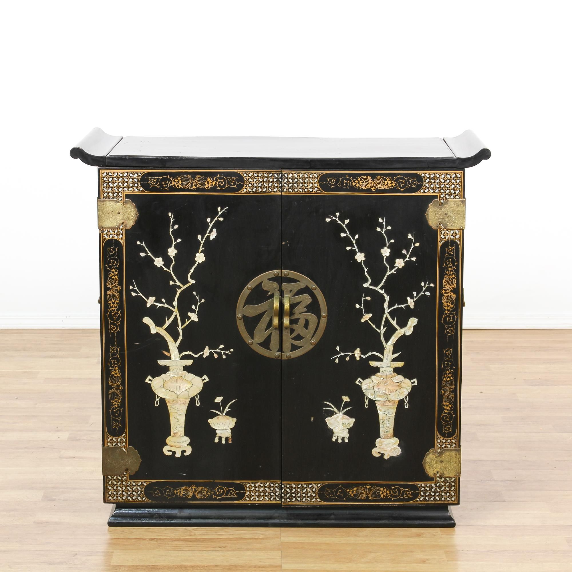 This asian bar cabinet is featured in a solid wood with a glossy ...