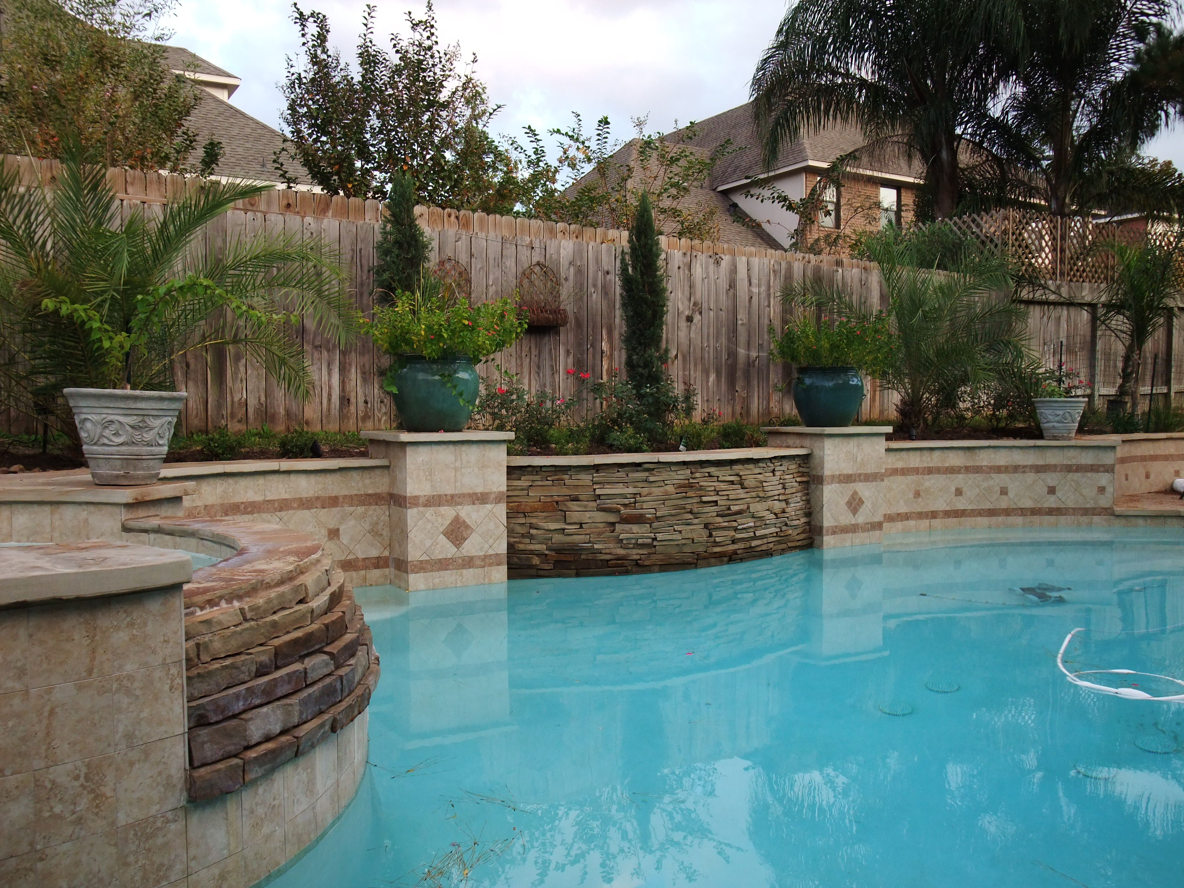 Stacked stone water feature - Stacked Stone Weeping Wall Water Feature In The Middele And Waterfall Off Hot Tub