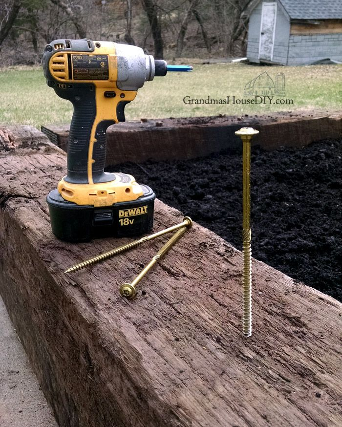 A New Vegetable Garden Made Of Railroad Ties And How I Made The Gate And Put A Fence Around It Balanci Railroad Ties Landscaping Railroad Ties Garden Railroad