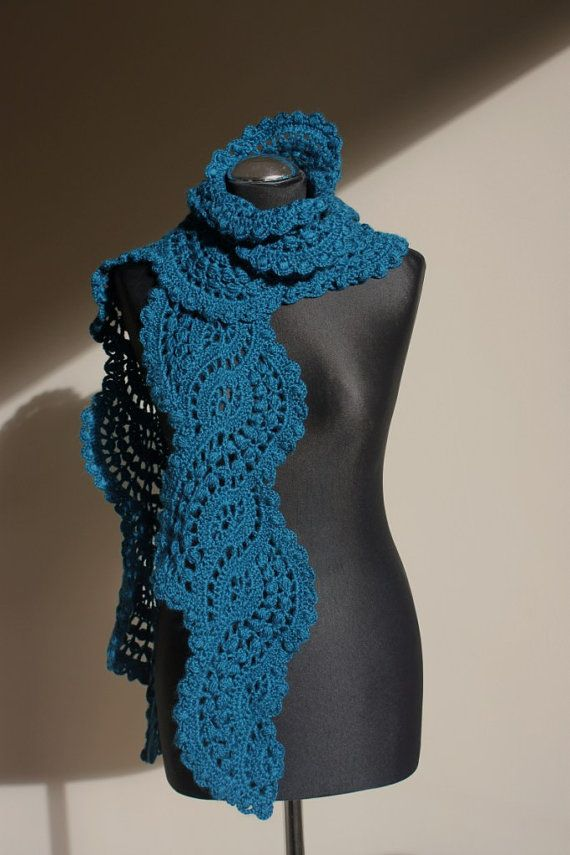 Crocheted lace scarf in turquoise teal