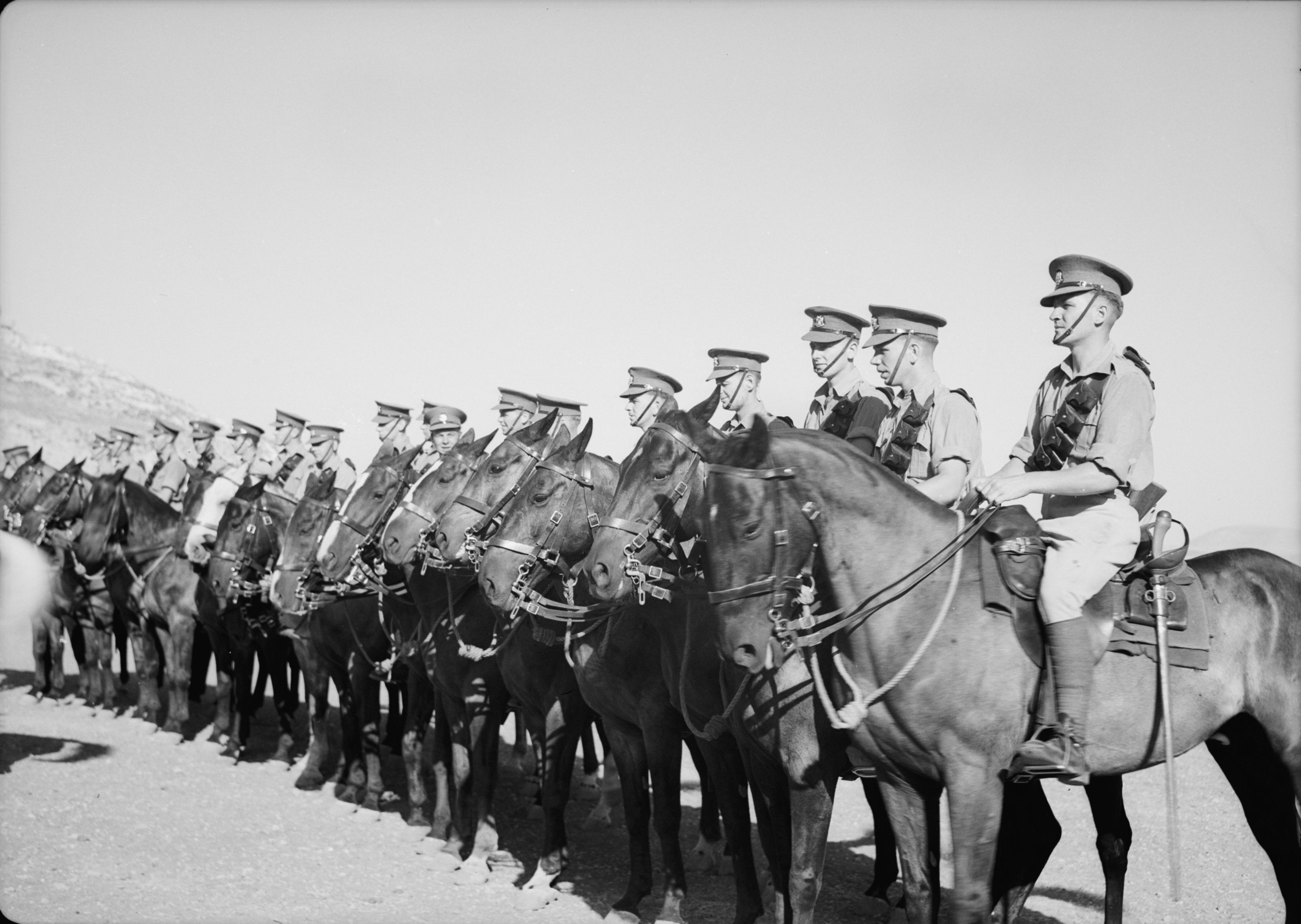 "Scots Dragoons of the ""Royal Scotts Greys"" Regiment fall in on horseback near Nablus, Palestine on July 31, 1941. The photo was taken after the regiment returned from fighting in Syria and Lebanon. Subsequently, the Royal Scots Greys transitioned to mechanized and were deployed in Libya. Note the perfect condition of the horses' accoutrements."