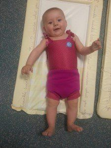 Making progress at baby swimming lessons - with baby emma in swimming costume and ready to go!