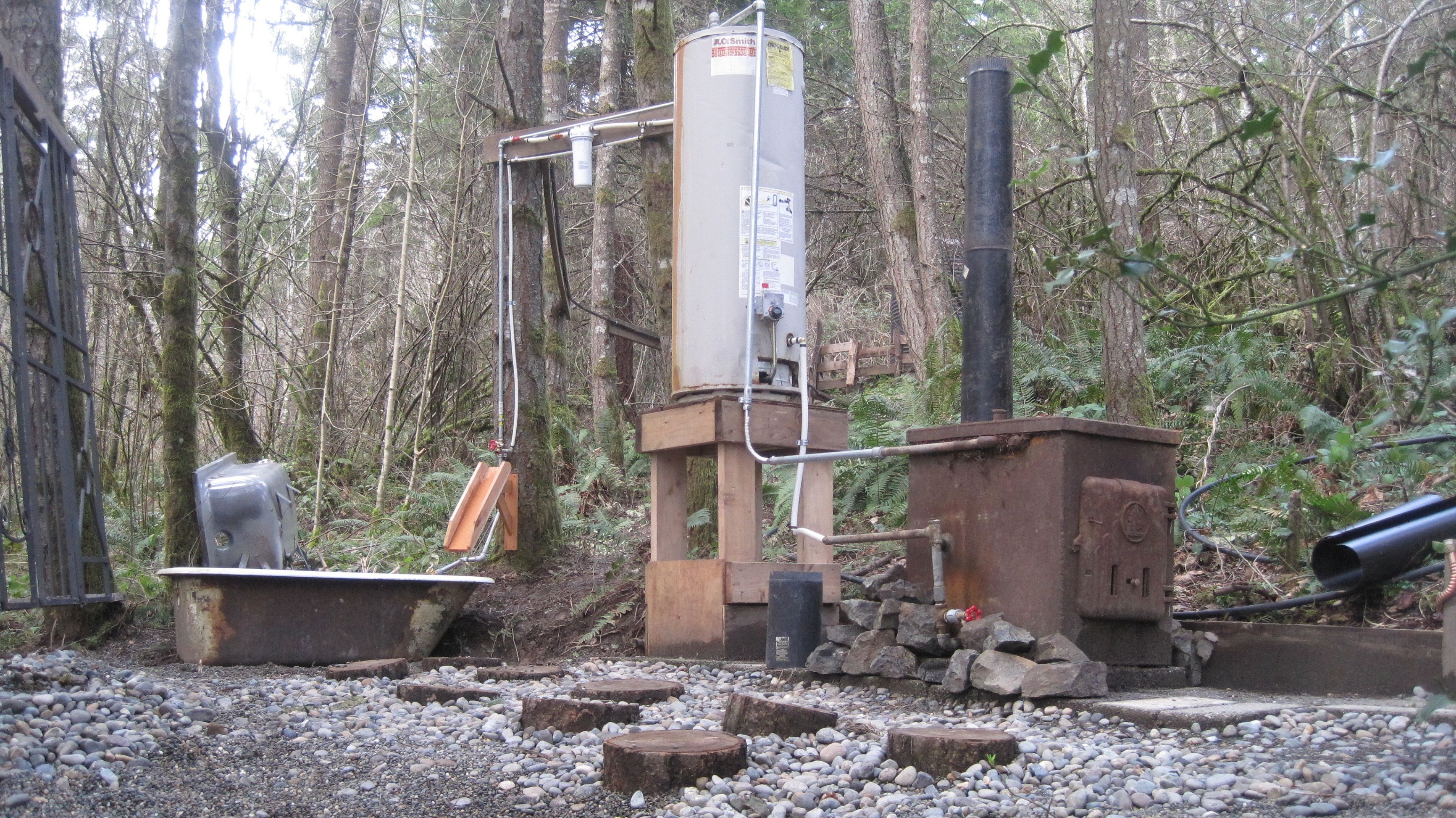 The off grid wood fired water heater for our outdoor bath