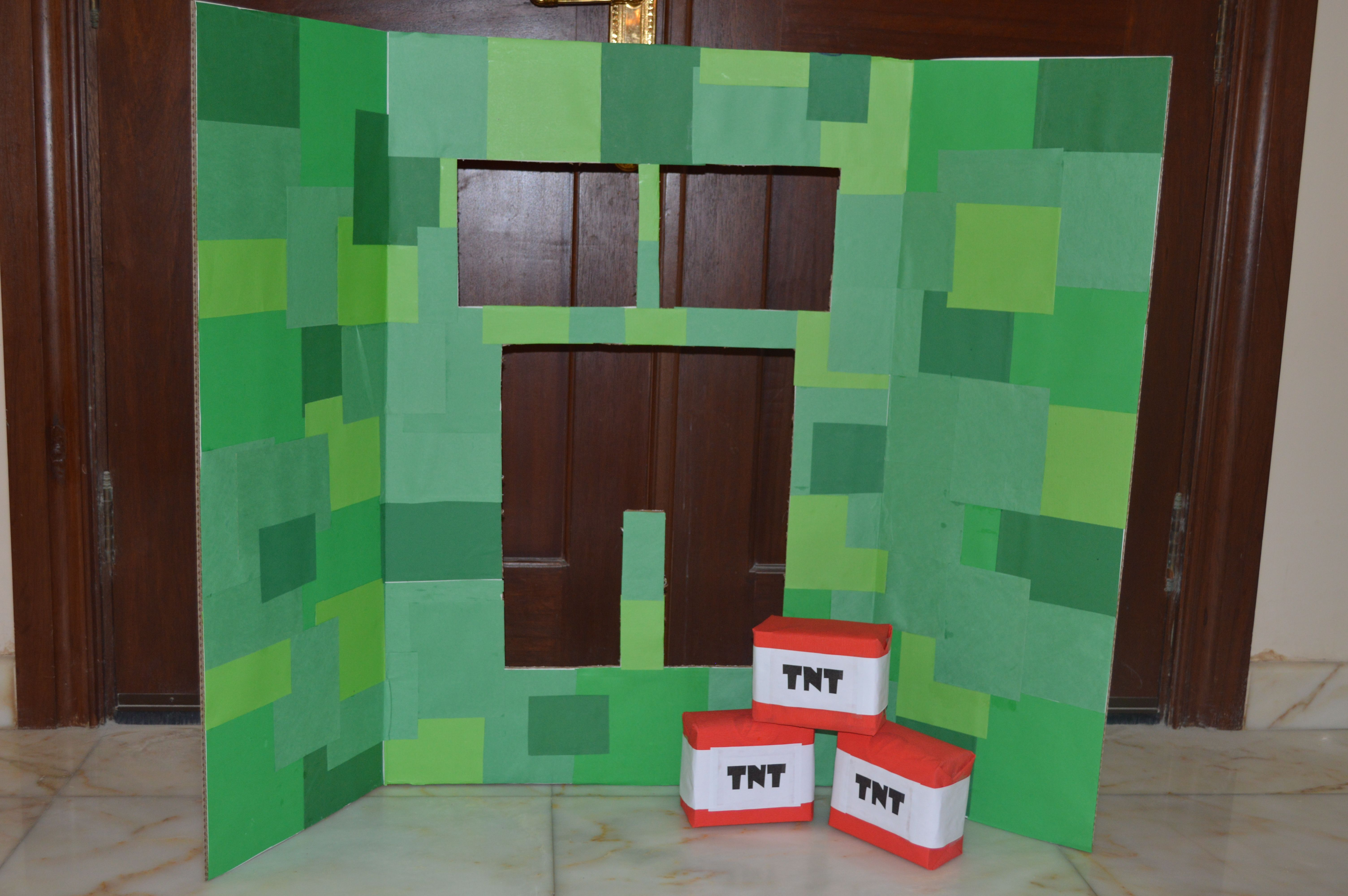 Creeper Toss --- a huge hit for the little ones including the not so little ones. :-D This took hard work. Had to cut and paste different shades of green squares to hopefully get the creeper face effect. I also had to wrap 3 small boxes with red crepe paper and labeled them with TNT printout. :-)