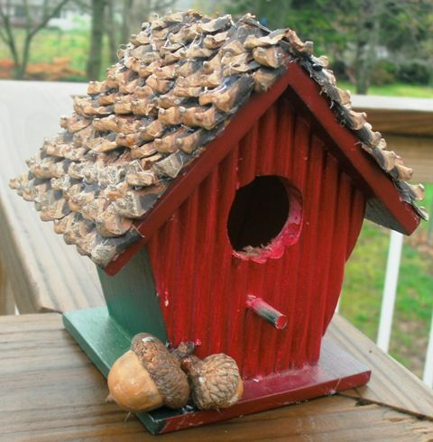 here's my little birdhouse I added pine cone pieces to make a lovely roof