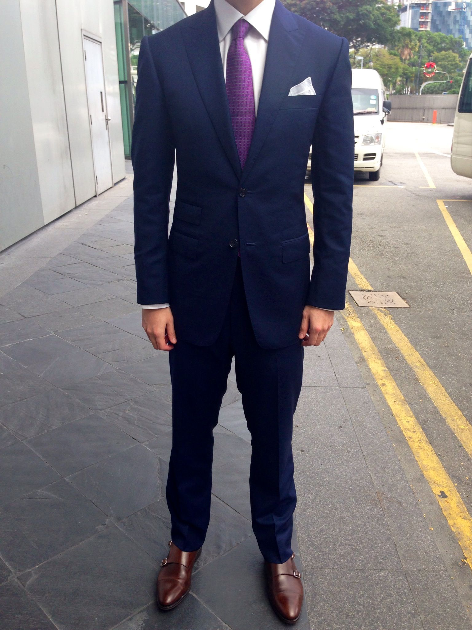 GROOM: navy blue suit purple tie