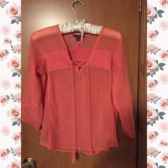 American Eagle Peasant Style Blouse Coral in color. The fabric is semi-sheer, so it needs to be layered over a camisole. Like new. American Eagle Outfitters Tops Blouses