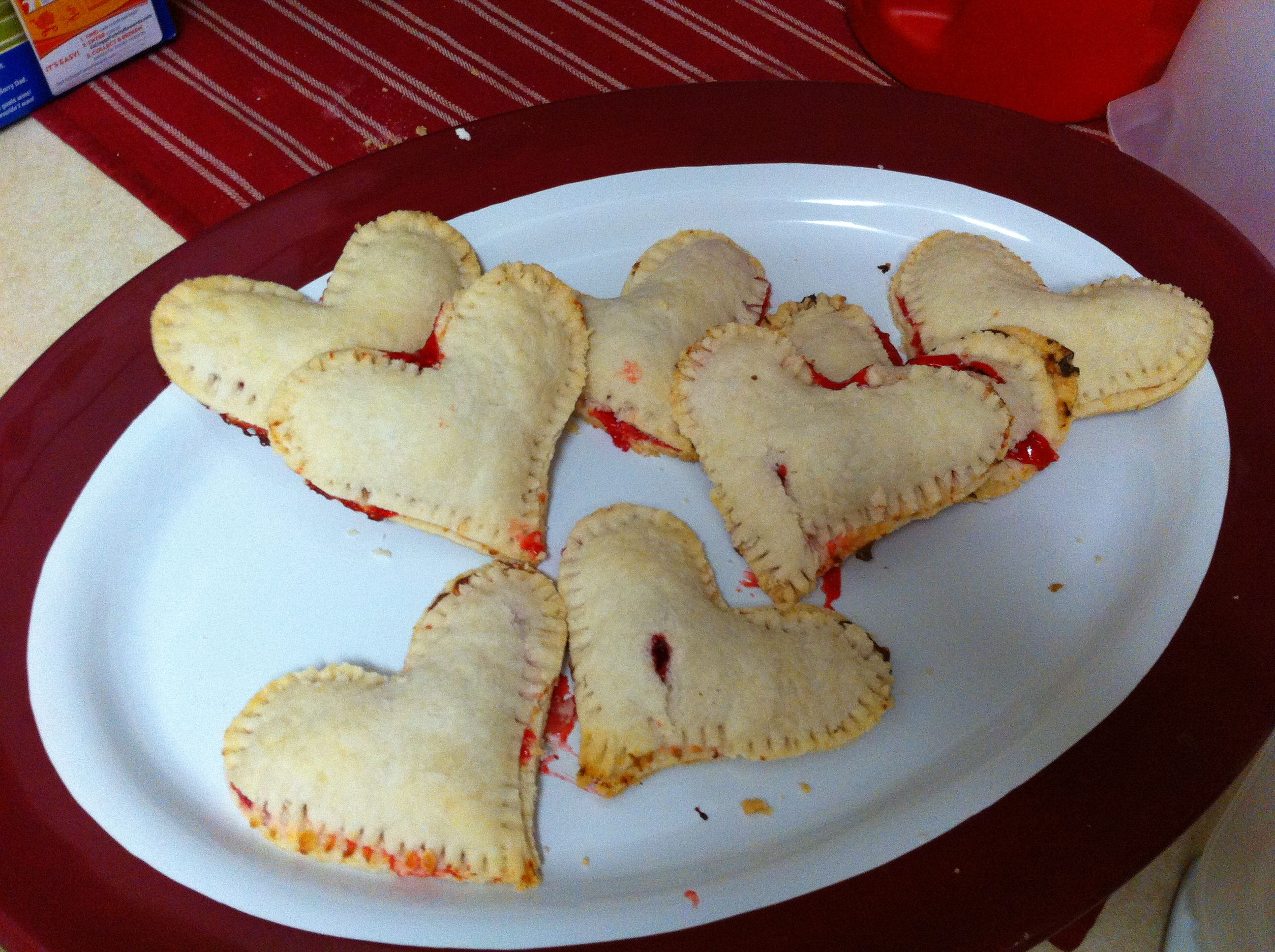 Individual cream cheese and strawberry pies for Valentine's Day