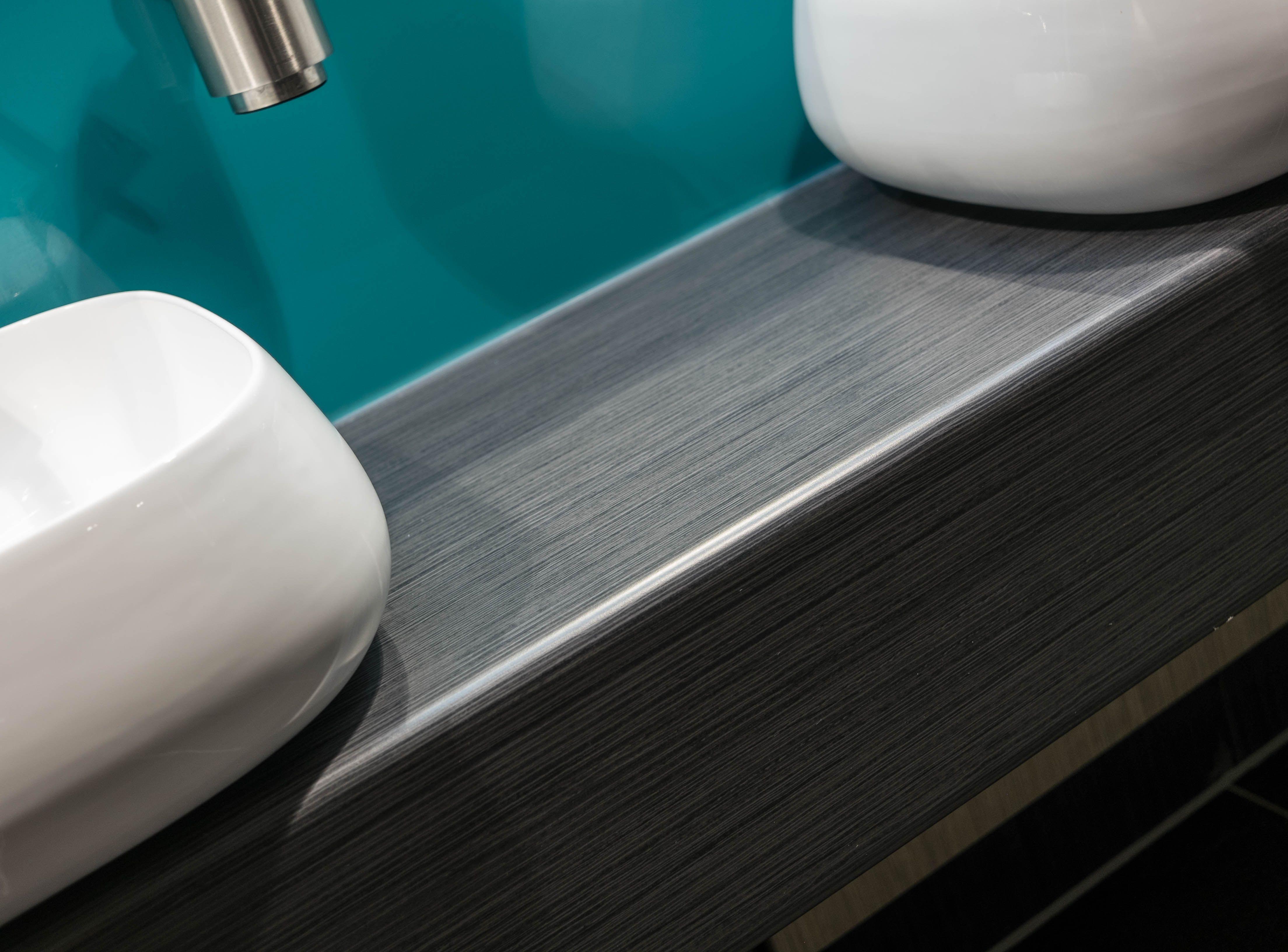 Vanity units  - postformed tops in matching woodgrains and china basins.