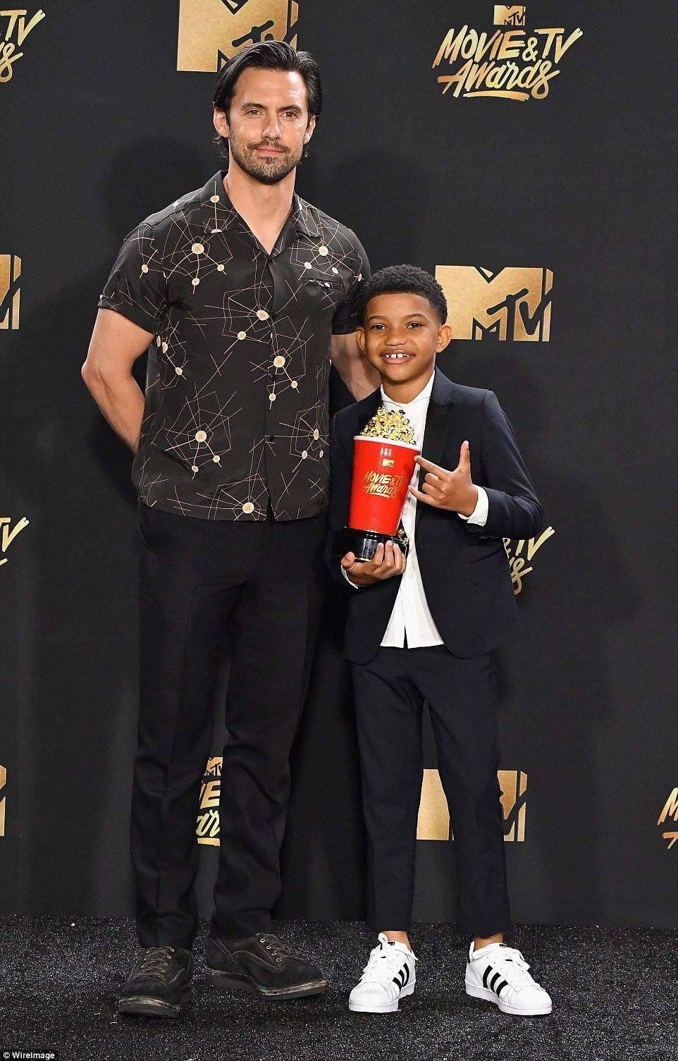 Karate kids: Milo Ventimiglia and Lonnie Chavis who picked up the popcorn trophy on behalf of best tearjerker - the NBC drama series This Is us