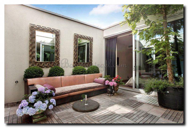 Vergroot de patio tuin met twee spiegels aan de muur tuinspiegel