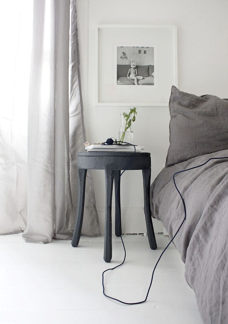 Beautiful grey bedroo with long curtains