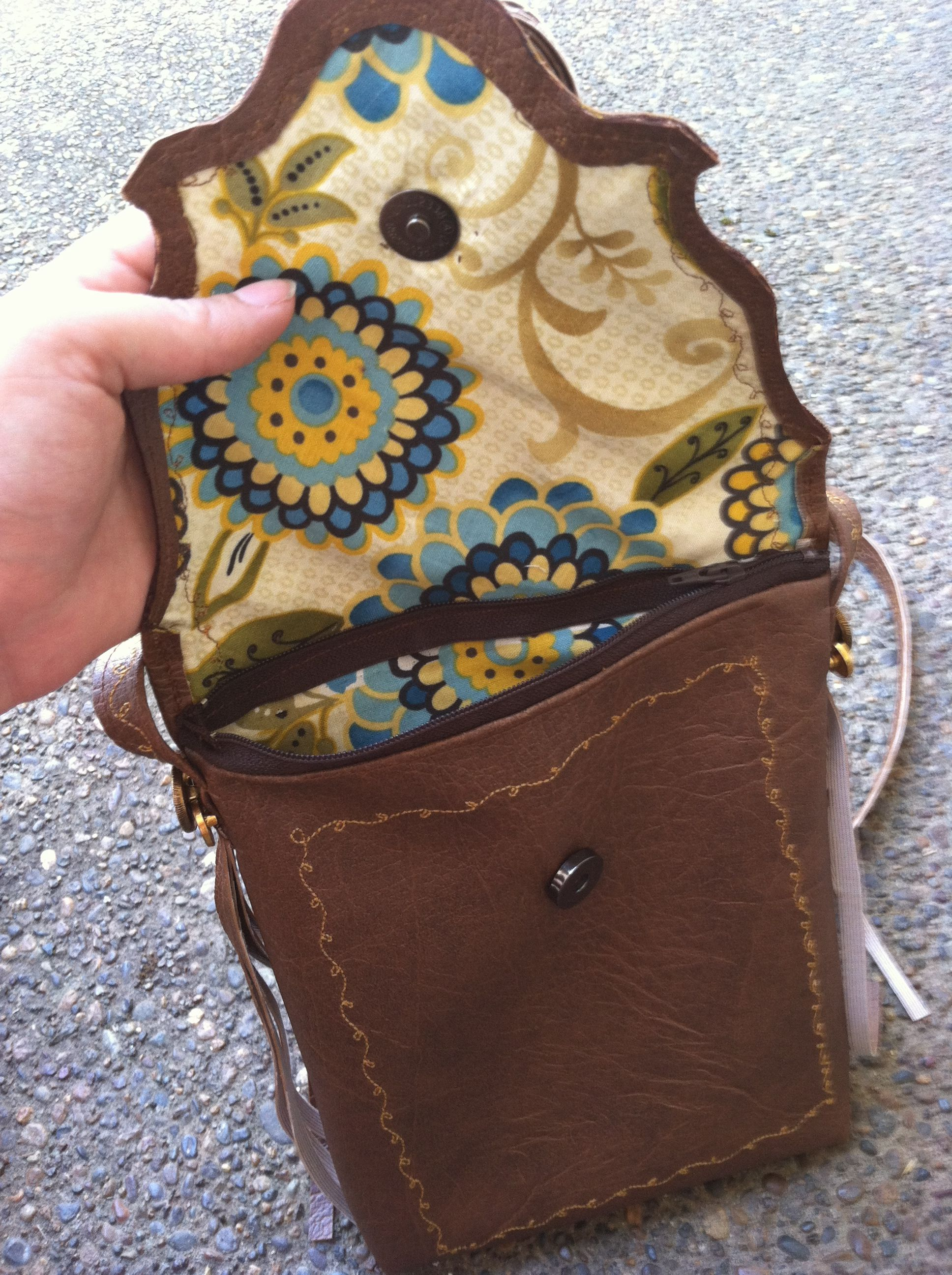 Brown vinyl with cotton lining, magnetic and zipper closure