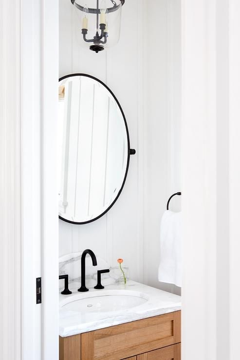 Small Cottage Powder Room Features Walls Clad In Board And Batten