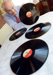 Maurice Woods from Shipdham, went to the Queen's coronation 60 years ago and still has memorabillia from the day - Maurice with the vinyl records of a recording of the coronation.