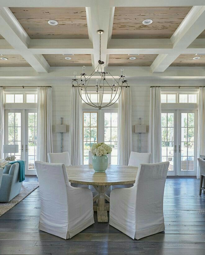 Glossy White Coffered Ceiling Accented With Pecky Cypress Coffers An Iron Chandelier The Round Salvaged Wood Dining Table Surrounded By
