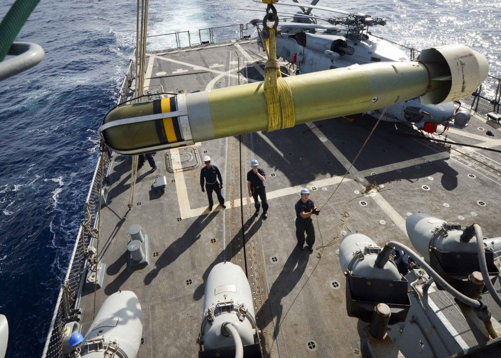MEDITERRANEAN SEA: Sailors aboard the Arleigh Burke-class guided-missile destroyer USS Winston S. Churchill (DDG 81) maneuver a Mark-54 torpedo to the flight deck. (U.S. Navy photo by Mass Communication Specialist 3rd Class Taylor N. Stinson/Released)