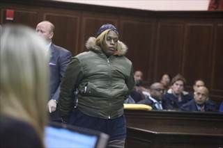 King showed no emotion in court Friday as she was charged and ordered held on $500,000 bail.