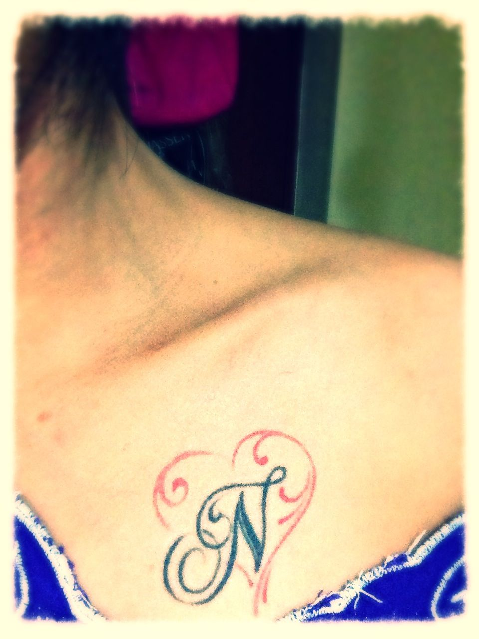 tatto with my son name initial N ..i like the red heart