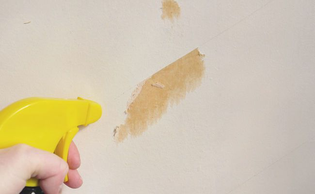 Spraying hard to remove remnants with warm water or