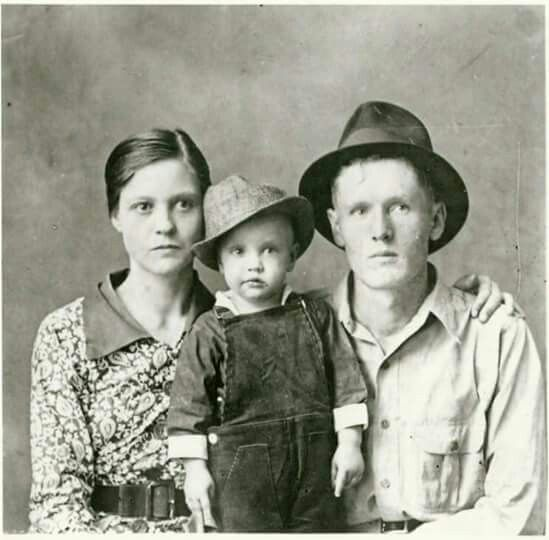 The earliest known photo of Elvis Presley and his parents Gladys and Vernon in 1937.