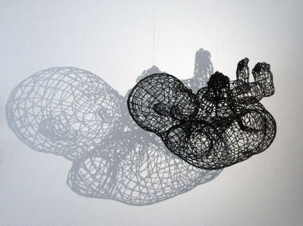 German artist Moto Waganari crafts intricate human sculptures using filigree wires, but there are hidden surprises in his works of wired art...