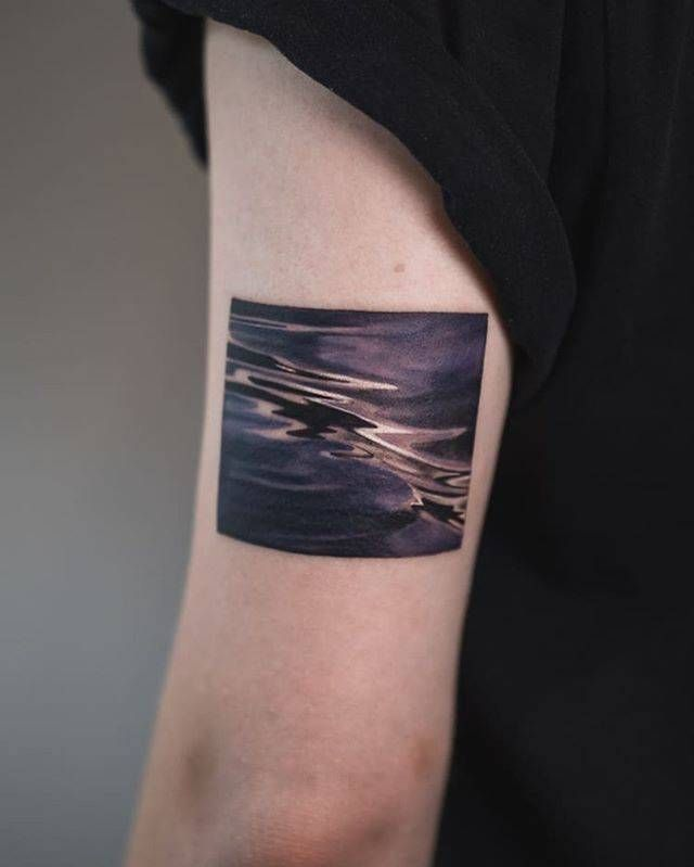 Square Tattoo: Water Square Tattoo On The Back Of The Left Arm.
