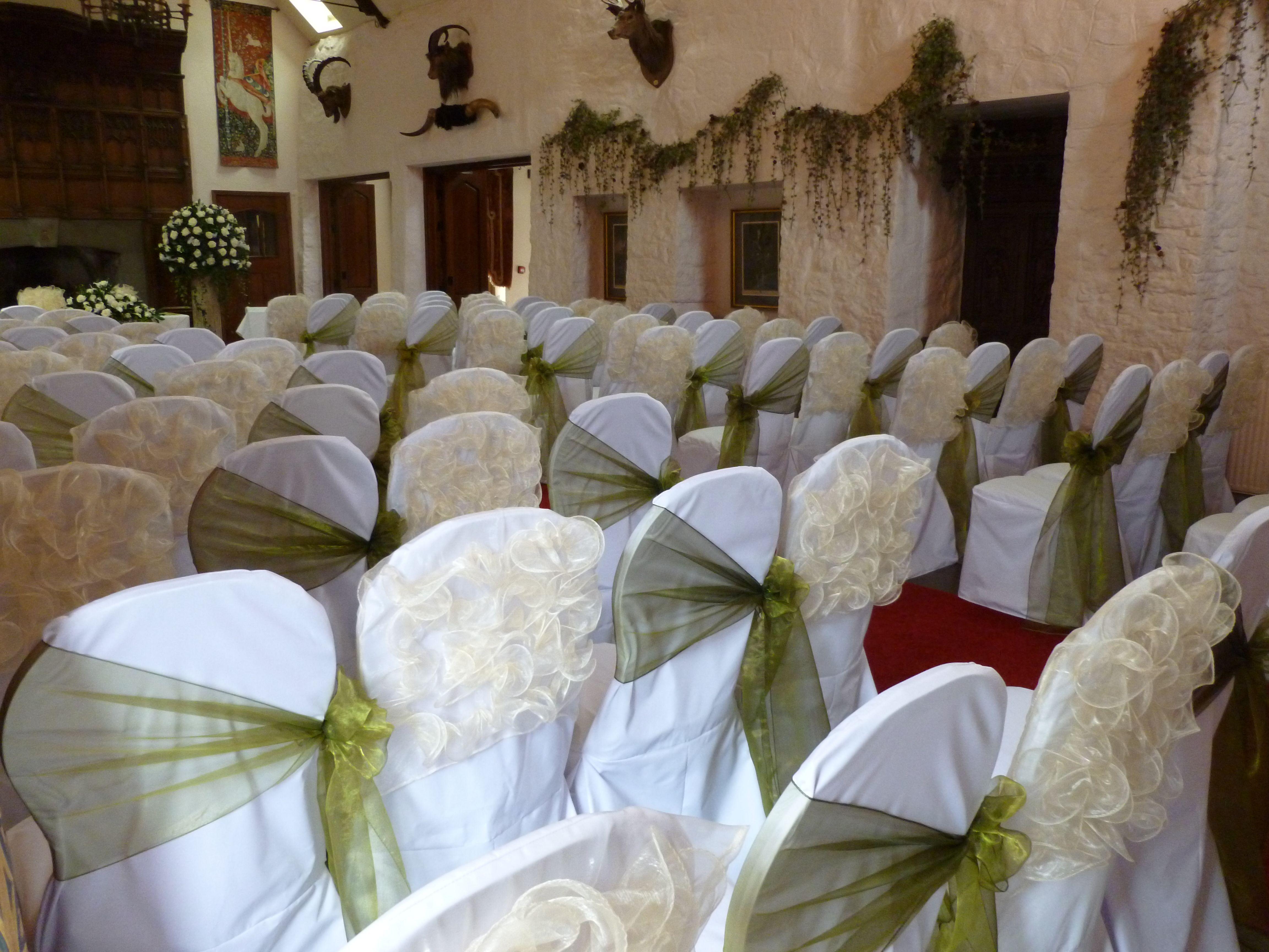 Champagne chair frills mixed with Olive Organza bows Miskin Manor