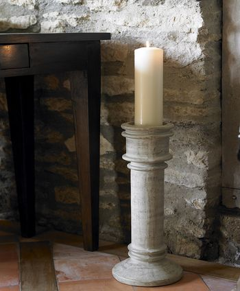 Floor-standing ceramic candle holder