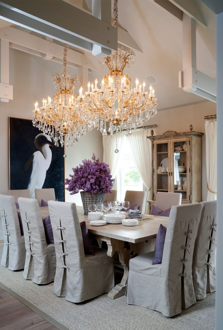Grey And Cream Interior Dining Room With Large Golden Chandeliers Lilac Flowers For A Centerpiece Dinning Chair CoversSlip