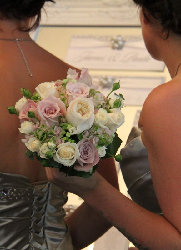 The Groom's Boutonniere featured a Faith Rose with Lily of the Valley, Blanchette Rose Buds with Lily of the Valley and Classic Hydrangea