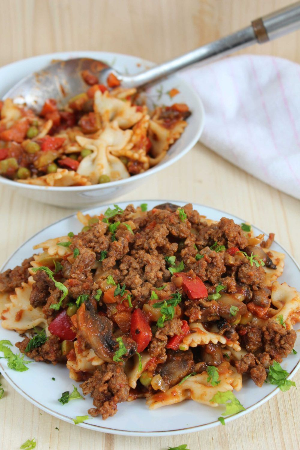 Pasta With Ground Beef And Roasted Vegetables On A White Plate Beef Pasta