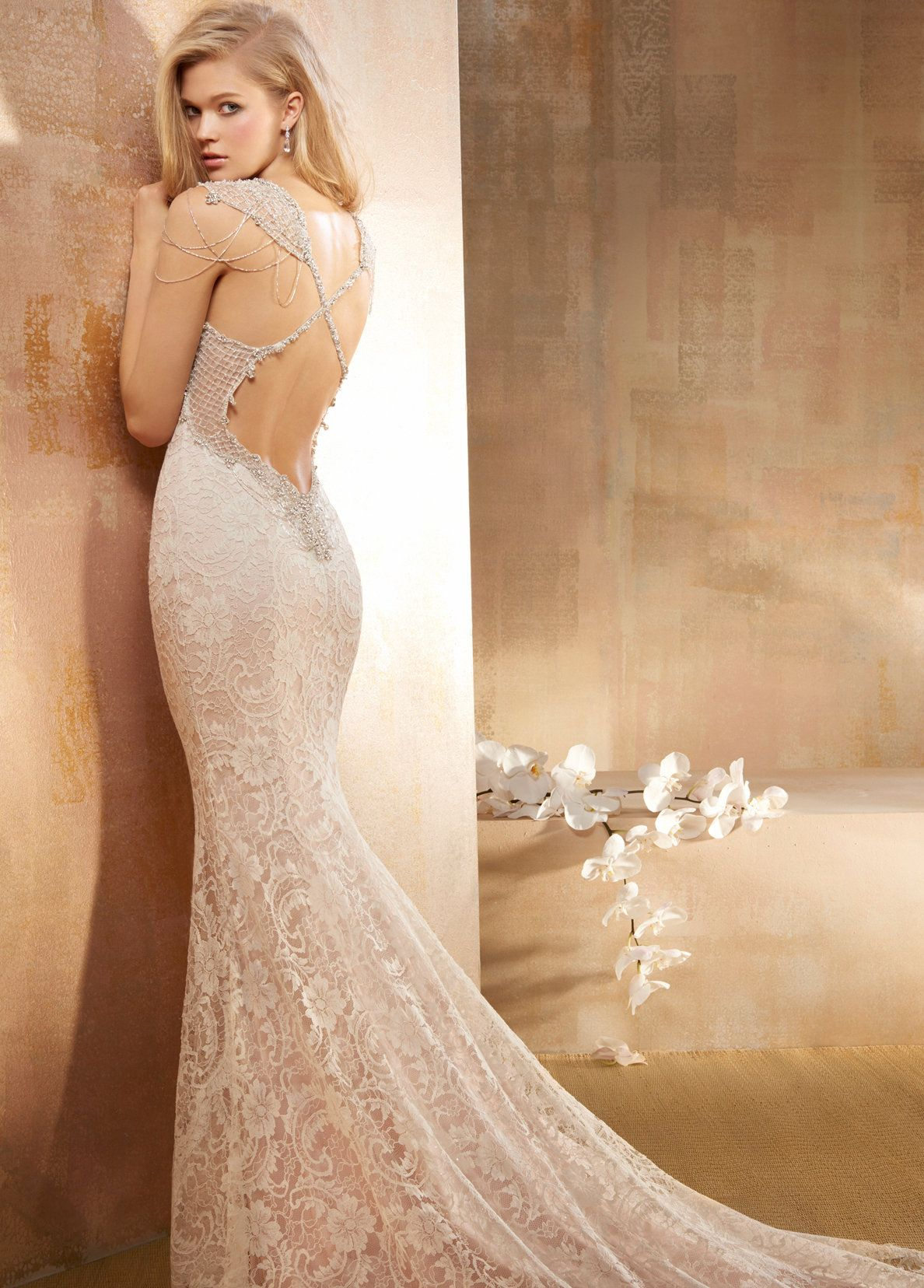 Popular Ivory French corded lace over Rum Pink Charmeuse soft fluted bridal gown with shimmer throughout