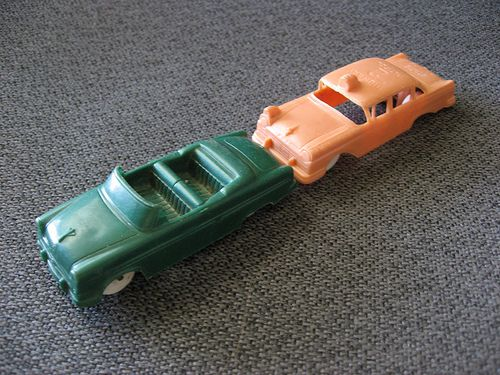 We played with these little plastic cars all the time when I was little.  They came free in boxes of cereal!