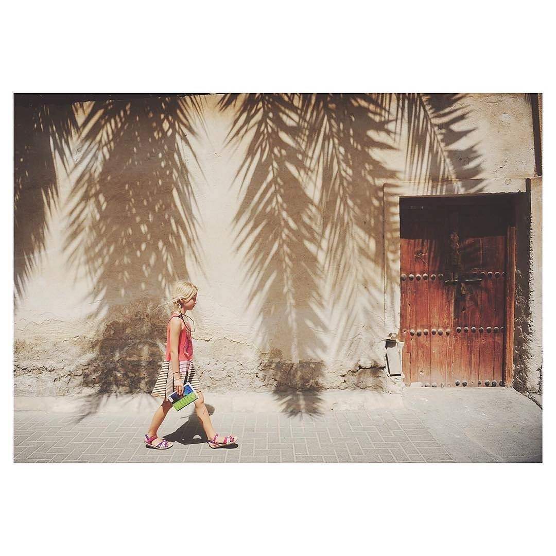 """""""Light shadows and crumbly old doorways"""" in #Muharraq #Bahrain captured by photographer Kristy Larmour (@kirstylarmour). To submit your images for consideration on our feed follow @childhoodeveryday and tag your photos #childhoodeveryday. // #street #streephotography #lightandshadow #composition"""