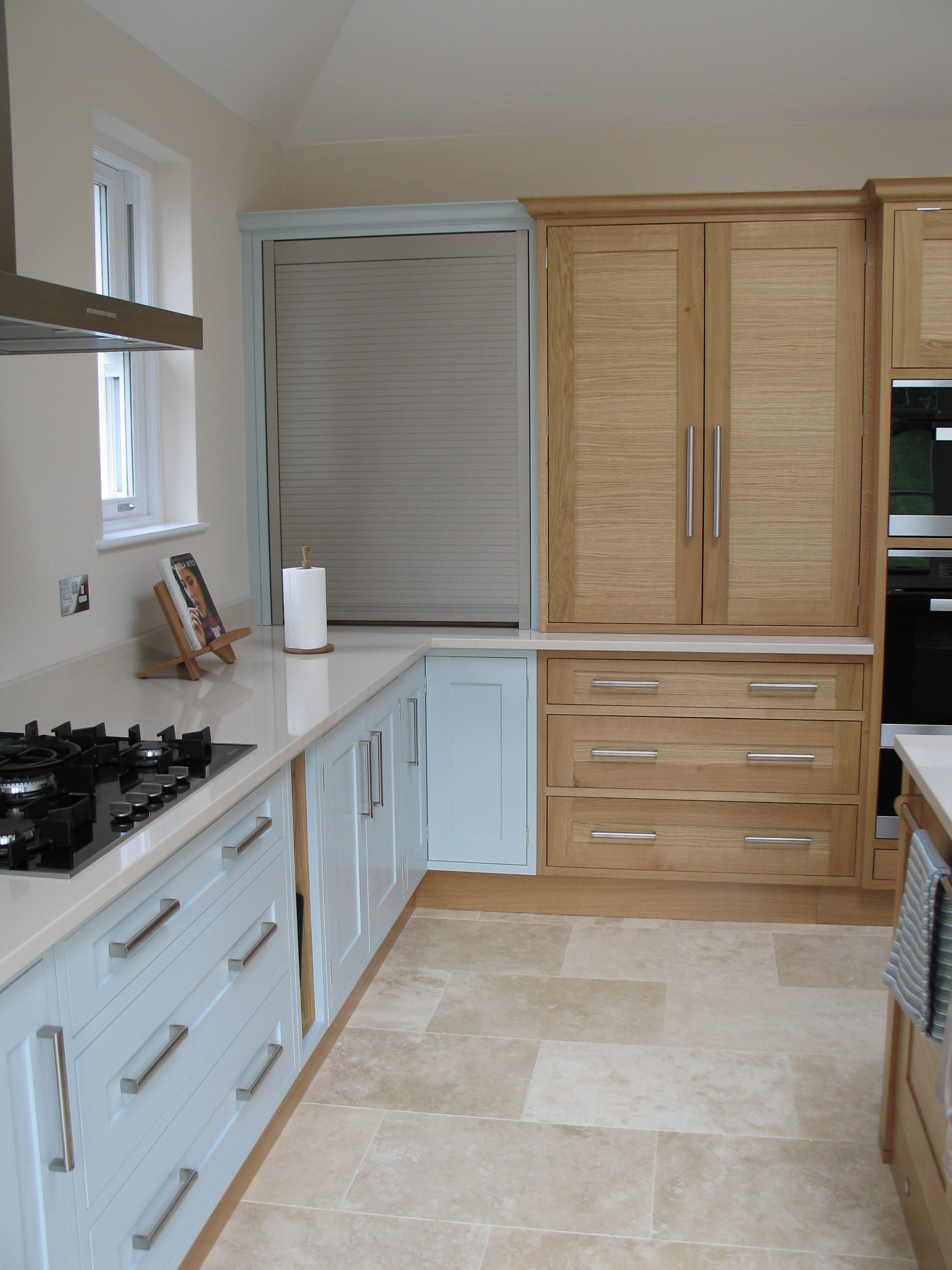 A Stainless Steel Tambour Door In The Corner Next To A Counter Top