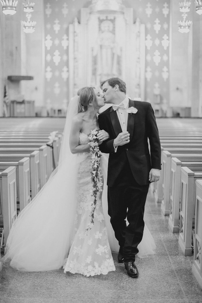 Bride & Groom End Ceremony with a Kiss | Photo: Shaun Menary Photography. View More:  http://www.insideweddings.com/weddings/modern-black-and-white-wedding-with-southern-traditions-in-dallas/916/