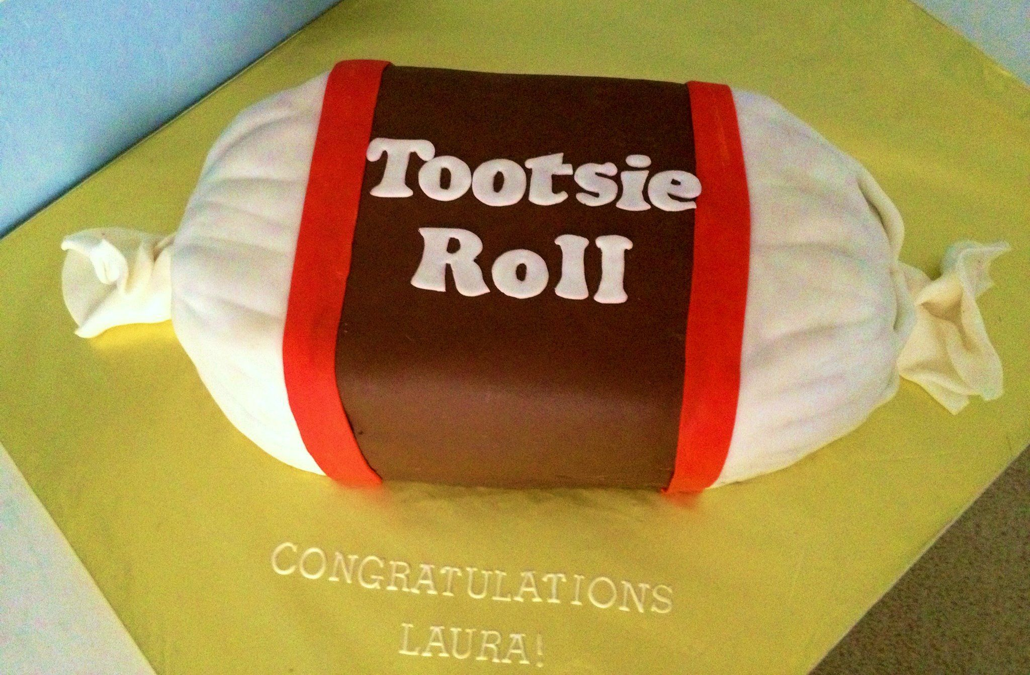 A very large Tootsie Roll cake for an fan!