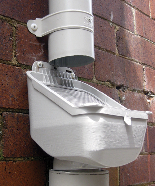 A photo of a leafshedding rainhead fitted to a downpipe