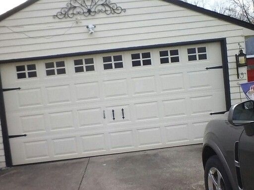 GARAGE DOOR MAKEOVER!   Magnetic Carriage House hardware from Amazon, $19.  3 rolls of peel and stick vinyl from Michaels, $30.  Getting the Carriage House garage door you've always wanted priceless!