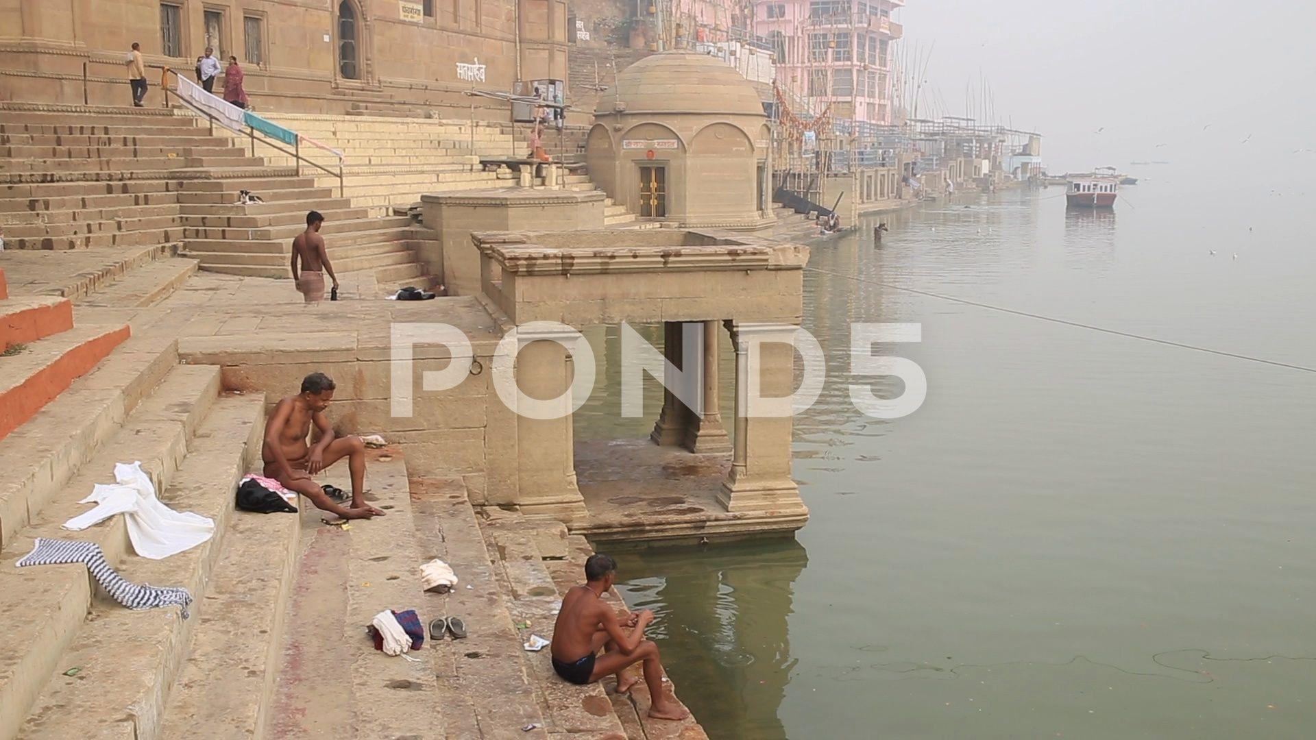 People sitting in a ghat Stock Footage sittingPeopleghatFootage