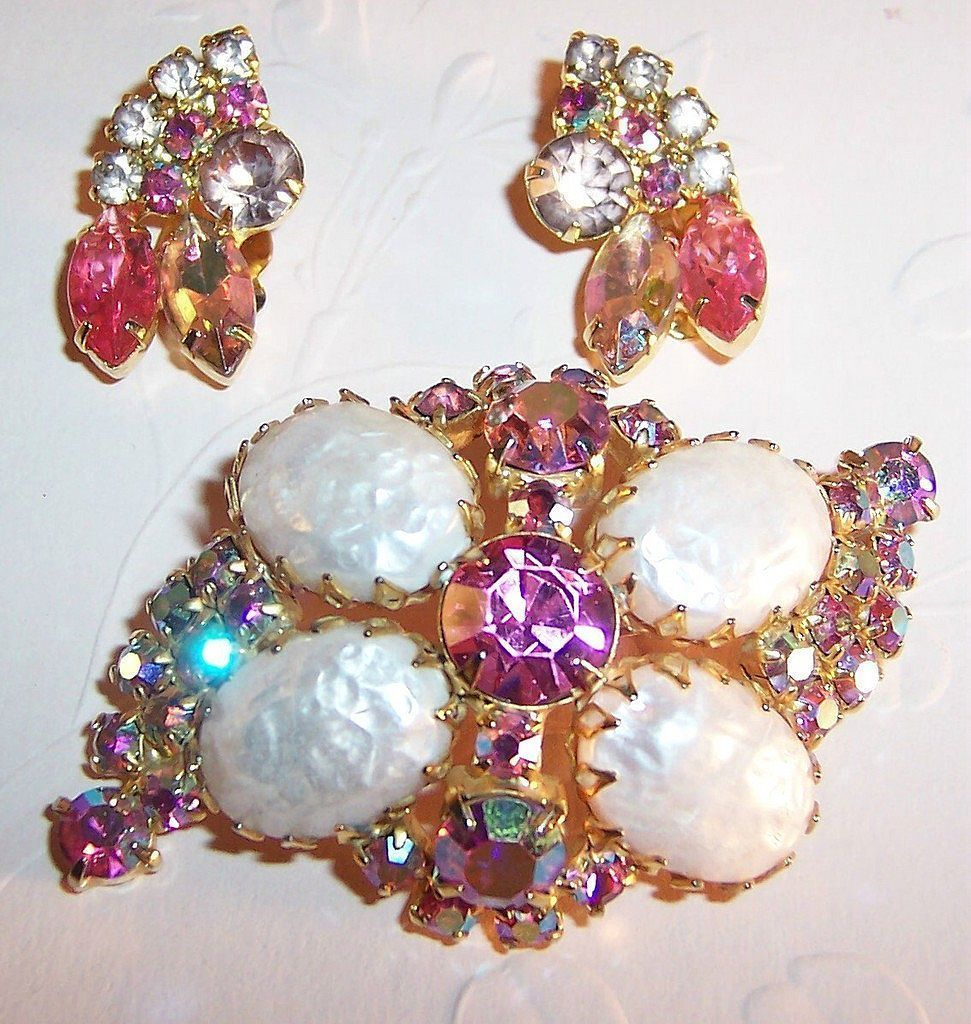 1950's Pink Brooch & Earrings Set / The shimmering iridescent colors change depending on the angle of the light that hits the sparkling pink, then fuchsia, then lavender aurora borealis stones in the brooch and earrings. The round center rhinestone of the brooch predominantly looks pink & matches the pink marquise in each earring. The brooch also offers four large Easter Egg shaped stones --faux baroque pearls, which were made so popular in the 1950's by Miriam Haskell. /68